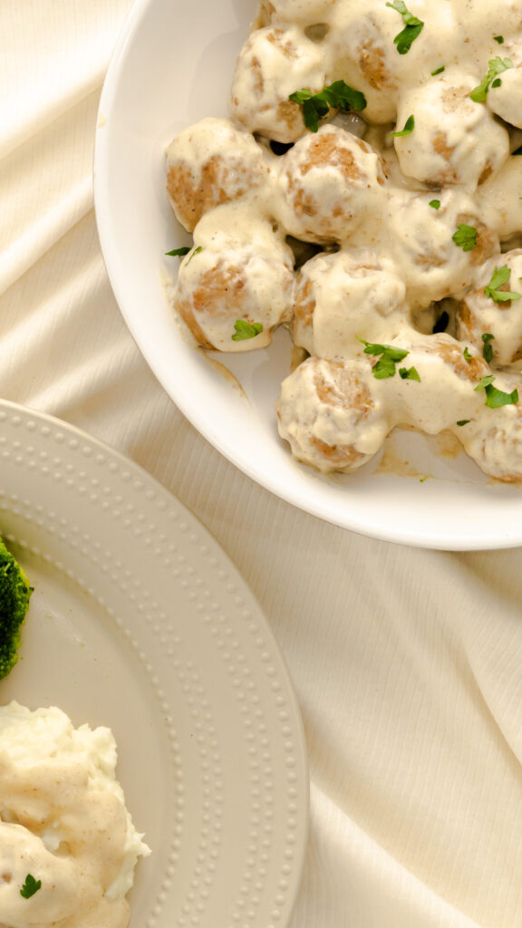 IKEA Swedish Meatballs copycat served in white bowl and garnished with parsley.