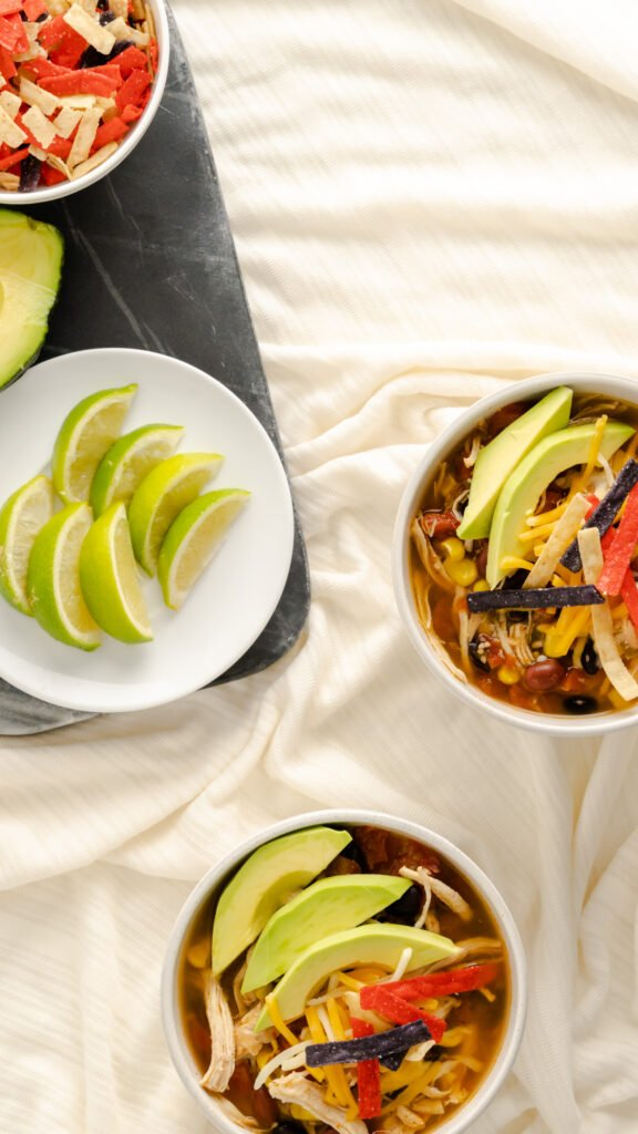 chicken tortilla soup with garnishments on side