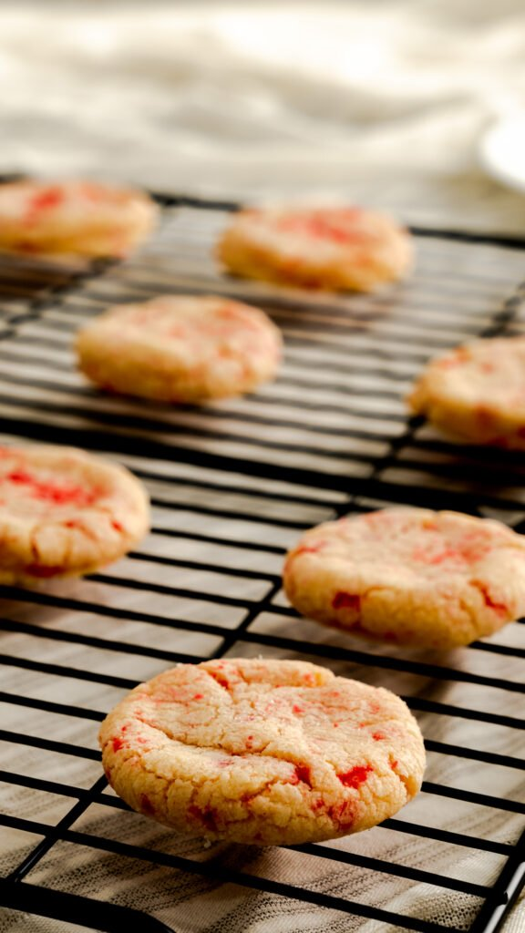 Side view of red hot cookies on wire rack.