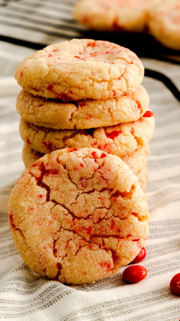 Close up of a stack of red hot cookies.