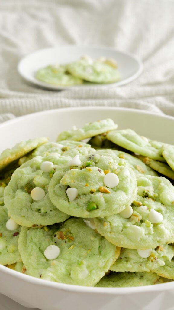 Platter of pistachio cookies in white bowl.