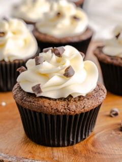 irish cream cupcakes on wood serving board