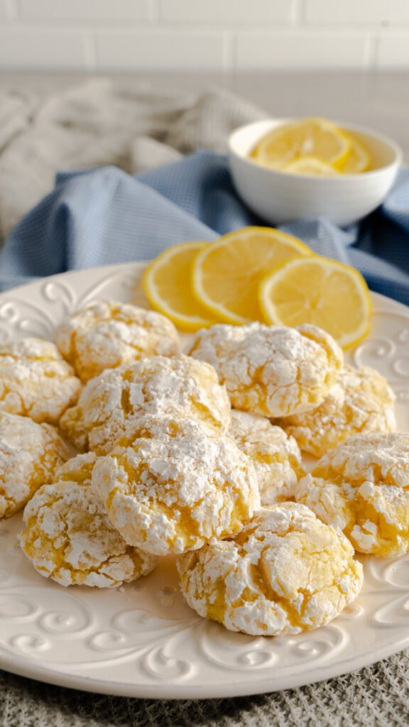 Platter of lemon crinkle cookies dusted with powdered sugar.