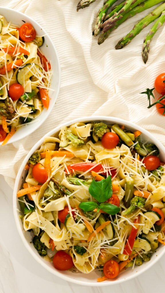 Flat lay of instant pot pasta primavera with asparagus, zucchini, and cherry tomatoes.