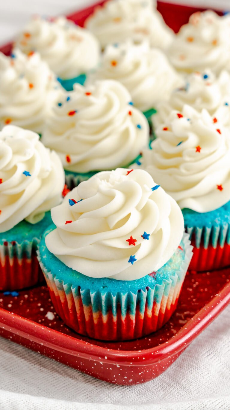 Red white and blue cupcakes topped with vanilla buttercream and patriotic star sprinkles.