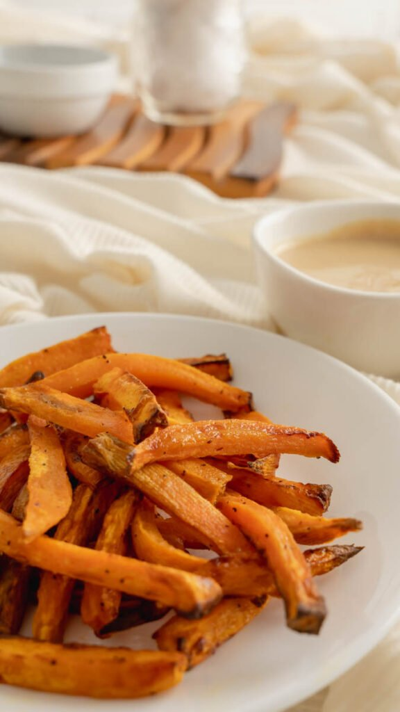 A plate of crispy sweet potato fries made in the air fryer.
