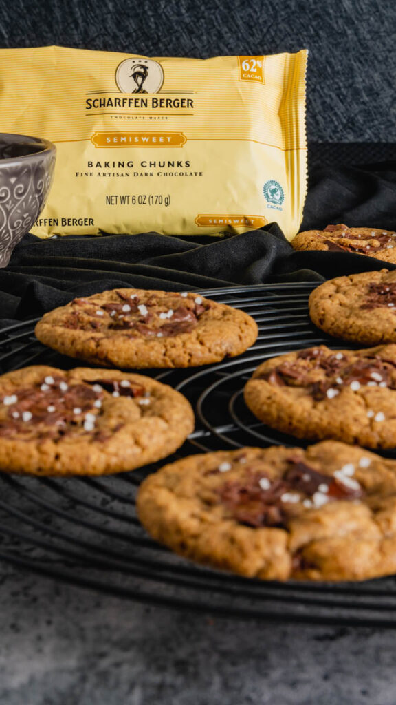 Brand packaging behind a black round cooling rack with cookies.
