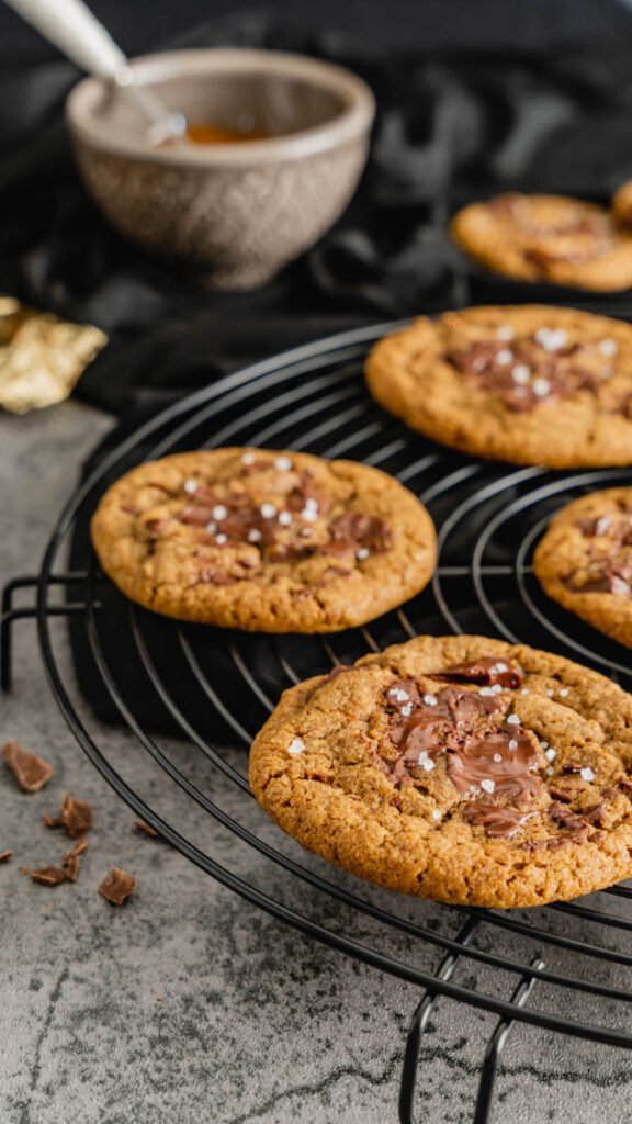A cooling rack of cookie made with espresso and melted chocolate.