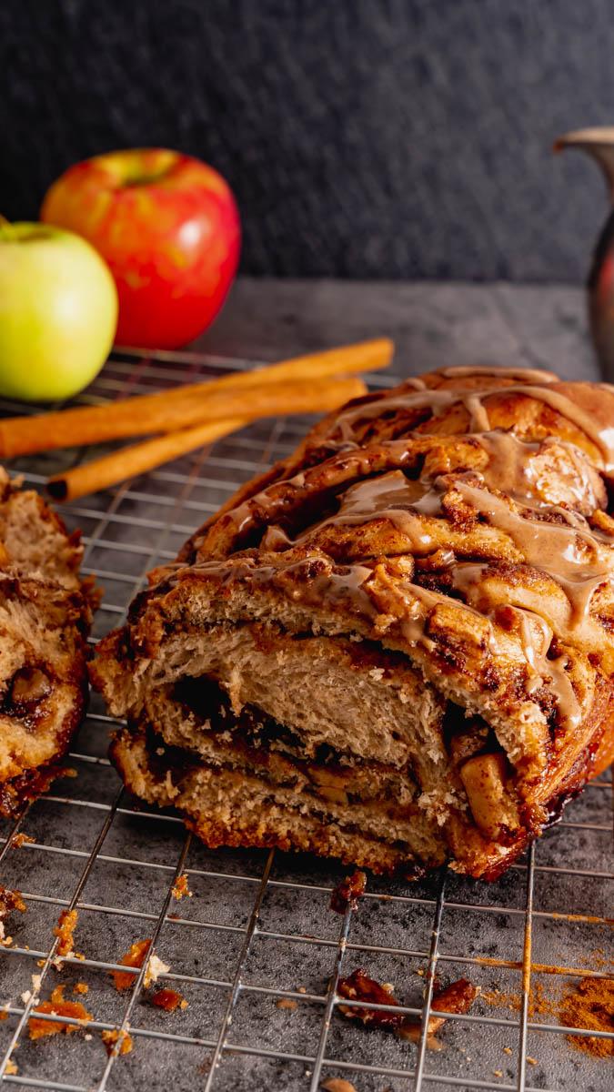 Apple Cinnamon Babka sliced with cinnamon glaze.