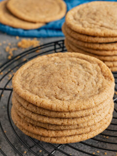 A small stack of brown sugar cookies on wire rack.