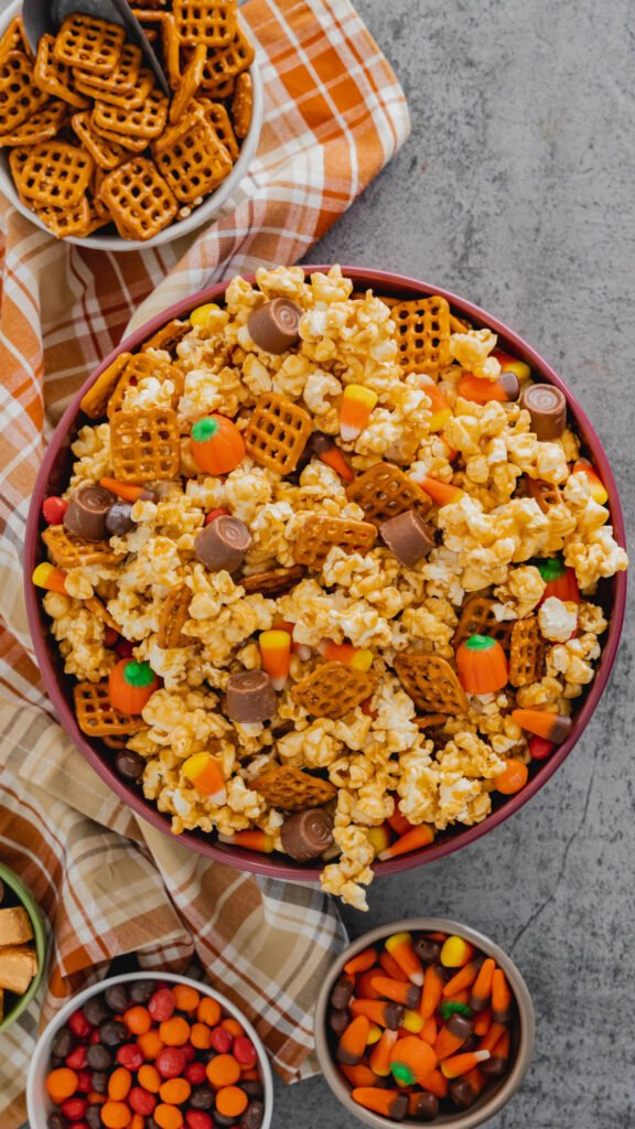 Harvest Popcorn Snack Mix made with caramel corn, M&M's, pretzels, and Rolos.